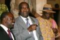 Le President Laurent Gbagbo entoure de Amouzou et Tape Doh