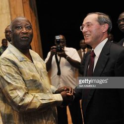 Elysee General Secretary Claude Gueant (R) shakes hands with Ivory Coast's president Laurent Gbagbo (L) upon arrival on October 2, 2010 in Yamoussoukro as part of a visit ahead of the October 31 poll. The election is intended to help end a crisis that has seen the west African country divided in two since a foiled coup against Gbagbo in 2002, when rebels of the New Forces (FN) took control of northern Ivory Coast.  Elections have been postponed seven times since Gbagbo's mandate expired in 2005, with the latest delay occurring in February when the head of state scrapped both the government and the Independent Electoral Commission (CEI).AFP PHOTO SIA KAMBOU (Photo credit should read SIA KAMBOU/AFP/Getty Images)