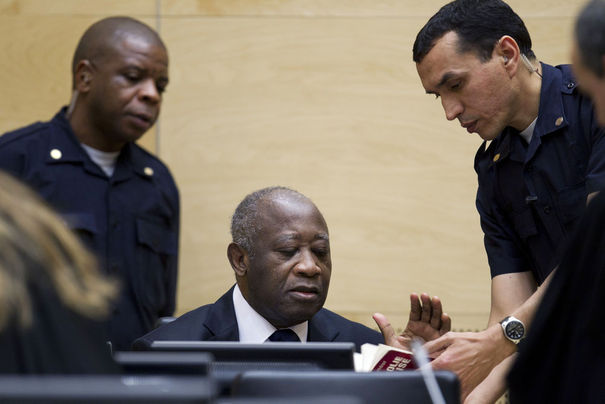 -s-former-president-laurent-gbagbo-talks-to-a-security-guard-during-his-initial-court-appearance-at-the-international-criminal-court-in-the-hague